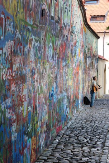 Absence Arrangement Art Art And Craft Blurred Motion Built Structure Creativity Fountain Graffiti Human Representation John Lennon Leading Lenon Wall Motion Narrow Outdoors Perspective Prague Rain Sunny Travel Travel Photography Urban Wall Wall - Building Feature