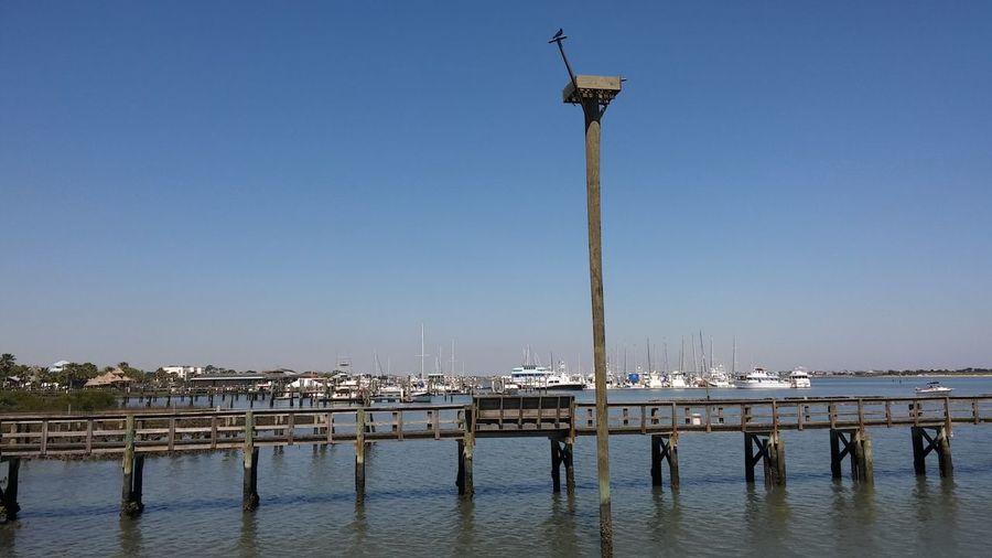 Harbor against clear blue sky