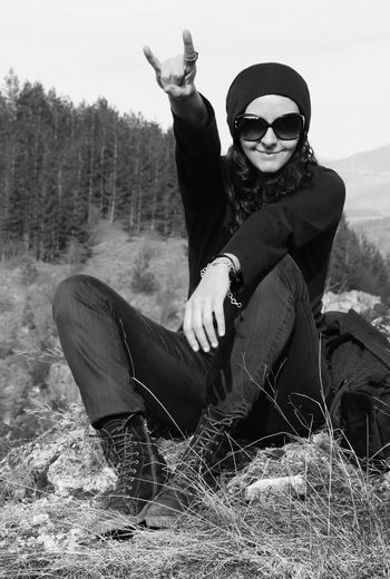 Woman shows a hand gesture, Rock and roll! Fun Lifestyle Portrait Of A Woman Rock Woman Black And White Black And White Photography Clothing Fingers Gesture Hand Gesture Leisure Activity Looking At Camera Monochrome Nature One Person Outdoors People Portrait Real People Rock And Roll Sitting Smiling Sunglasses Young Adult The Portraitist - 2018 EyeEm Awards