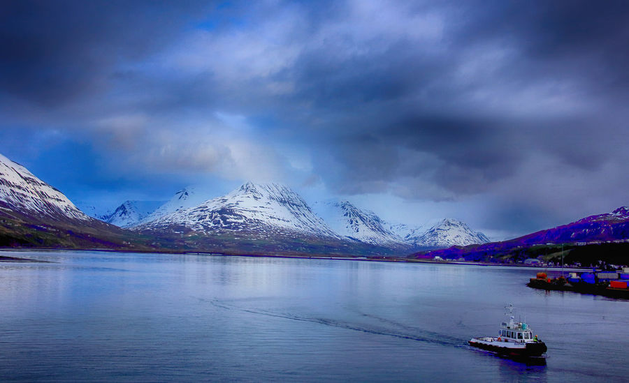 Pilot boat from Akureyri Iceland Akureyri Beauty In Nature Boat Cloud - Sky Cold Temperature Day Mountain Mountain Range Nature Nautical Vessel No People Outdoors Pilot Scenics Sea Sky Snow Tranquil Scene Tranquility Transportation Water Waterfront Winter