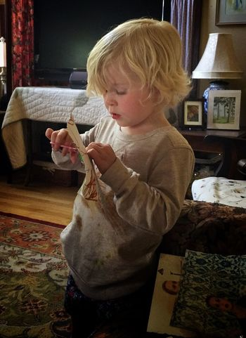 #Violet cutting up her project -- a #collaged cross (though she doesn't get the symbol) 13048553