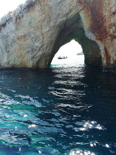 Natural Arch Nature Water Day Sea Boats Boats⛵️ Caves Blue Blue Sea Zakynthos,Greece Zakynthos Boat Trip Exploring Exploring Greece Rock Formation Ocean Boat Arch Natural Landmark Archway Arch Bridge