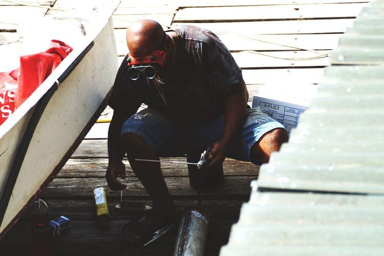Worker Workers Craftsmanship  Crafting Working Craftsman Repairs Repairing Repair Engineering Engineer Engine Mauritius Africa Simple Seaside Boat Boats Shop Vintage Working Hard Hardwork Steel Silver  Islandlife