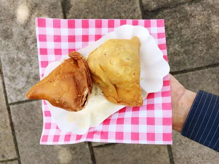 Street Food Indian Food Samosas Samosa Food Food And Drink High Angle View Checked Pattern Freshness Human Body Part Table Ready-to-eat Napkin One Person Day Close-up Snack