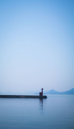 Japan Bay Beauty In Nature Blue Contrast Copy Space Horizon Idyllic Jetty Mode Of Transportation Nature Nautical Vessel negative space No People Outdoors Scenics - Nature Sea Seascape Shadow Sky Tranquil Scene Tranquility Travel Water Waterfront