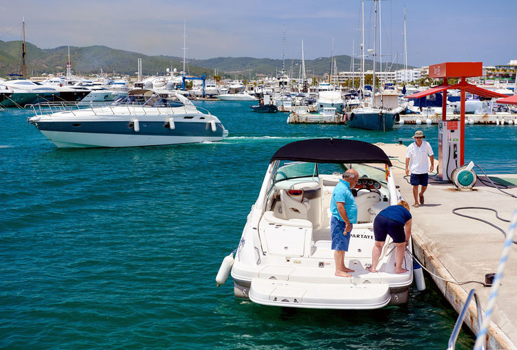 Ibiza, Spain - June 10, 2017: Cepsa Floating fuel station in Ibiza. Spanish multinational oil and gas company, Cepsa was founded in 1929. Balearic Islands. Spain CEPSA Company Eivissa Harbor Ibiza Multinational SPAIN Service Spanish Yachts Balearic Islands Boats Floating Fuel Station Fuel Station Fueling Gas Station Gasoline Station Motorboat Nautical Vessel Petrol Petrol Station Petroleum Refueling Sea Seaport