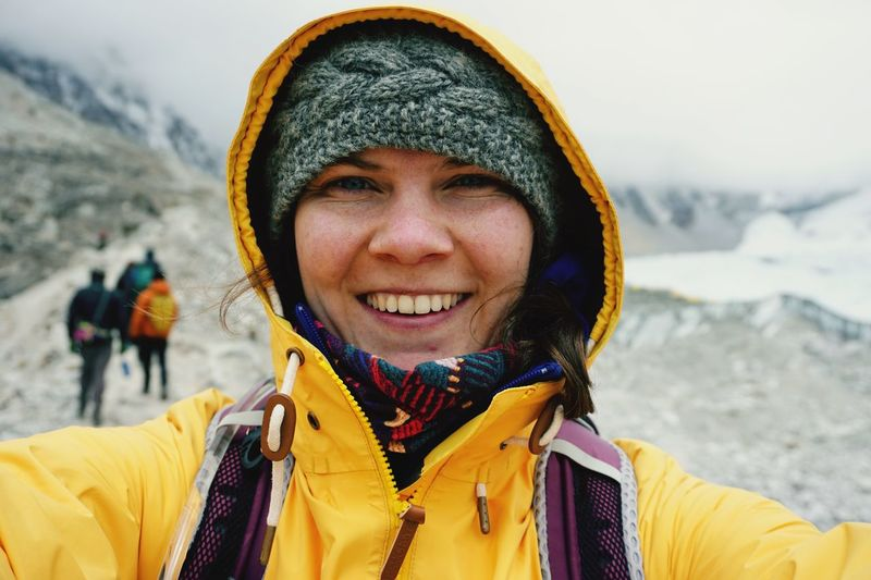 Portrait Of Cheerful Woman Wearing Yellow Jacket During Winter
