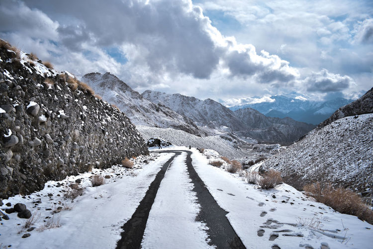 Snow Cold Temperature Winter Mountain Cloud - Sky Beauty In Nature Direction The Way Forward Scenics - Nature Transportation Nature Road Environment Sky Day No People Tranquil Scene Landscape Tranquility Mountain Range Snowcapped Mountain Diminishing Perspective Outdoors Leading Lines Parallel Lines