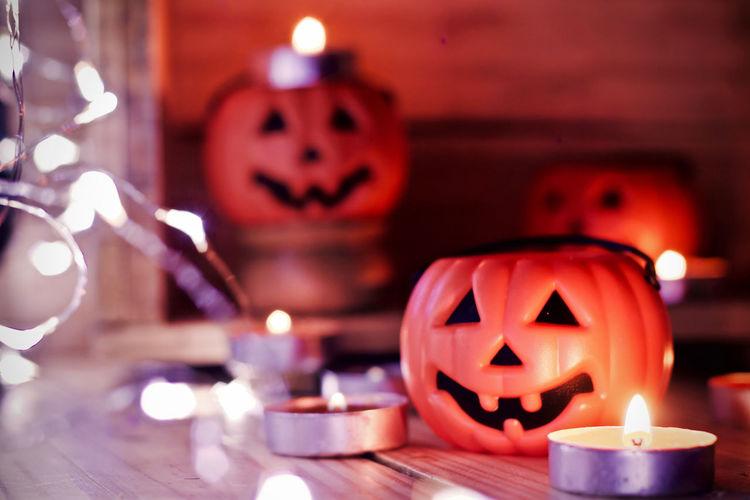 Close-up of illuminated pumpkin against blurred background