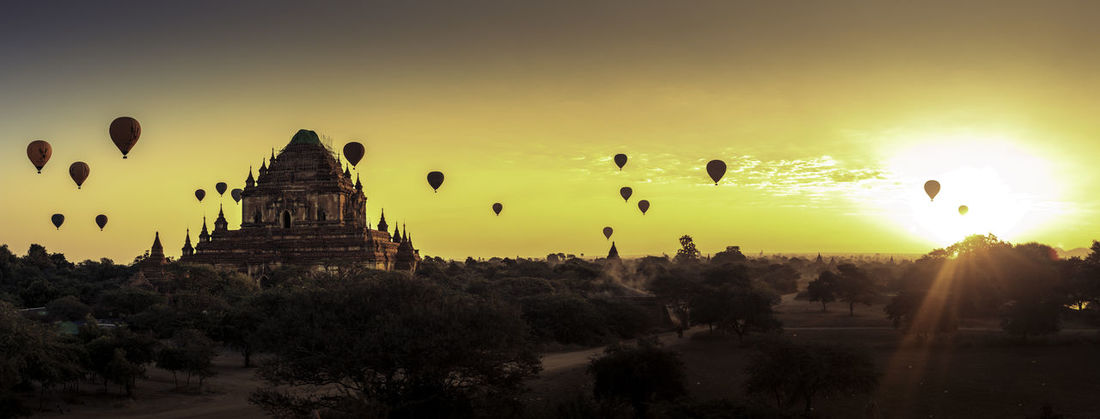 hot-air balloons over pagan temples in burma Hot Air Balloon Ballons In The Sky Pagoda Spirituality Bagan Burma Colored Sky Golden Hour Myanmar Panoramic Photography Sunrise Temple