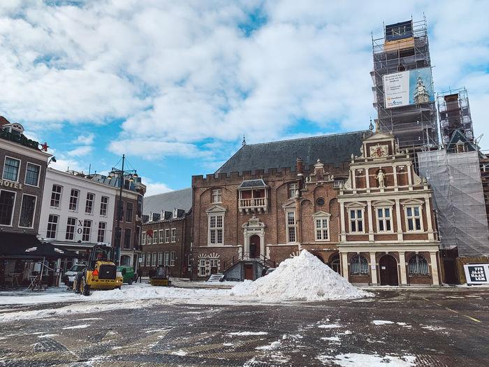 Buildings against sky in winter