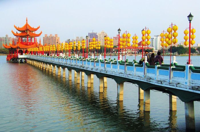 Asian Culture EyeEm Taiwan International Landmark Lake Pagoda Paper Lanterns Pedestrian Bridge Red Taiwan Tourism Walkway Water Yellow Colorful On The Water Travel Photography Traveling Colors Bridge Bridges