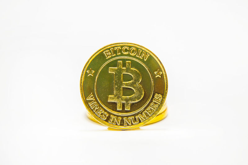 The Gold Bitcoinor BTC image Macro shots crypto currency Bitcoin coins electronic money. Bitcoin Bitcoin Cash Bitcoin Coin Bitcoin Miner Bitcoin Mining Bitcoin Stock Bitcoin Symbol Bitcoin Wallet Bitcoin Wallet App Bitcoins Business Close-up Coin Competition Currency Finance Gold Gold Colored Investment No People Savings Single Object Studio Shot Wealth White Background