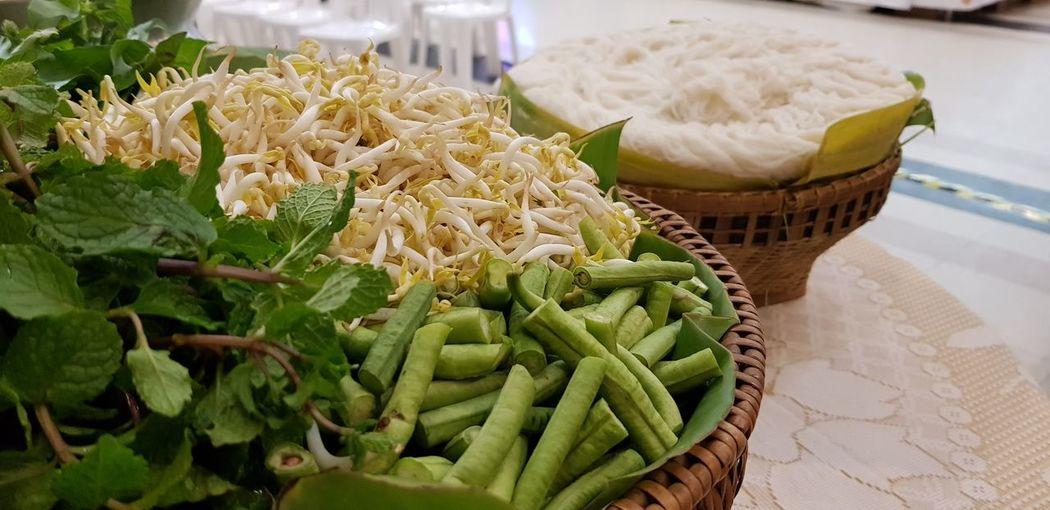 Thai sidedish vegetables in weaver basket with thai fresh noodle