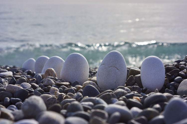 Beach Sea Large Group Of Objects Pebble Nature No People Wave Water Outdoors Close-up Day Out Of The Sea From Sea White Stone Round Stone Lined Stones Composition Break The Mold