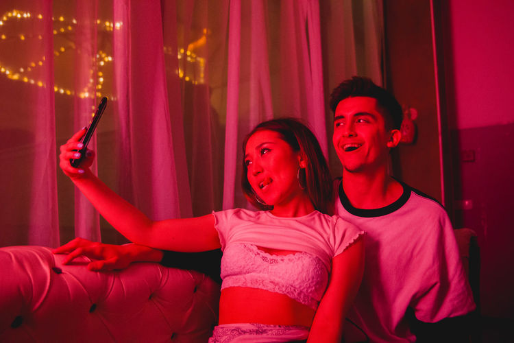 Neon Lights Lovely Couple Couple Green Love Pink Red Relationship Couple - Relationship Couples Indoors  Leisure Activity Lifestyles Lovely Neon Neon Color neon life Neon Lights Passion Real People Selfie Young Adult