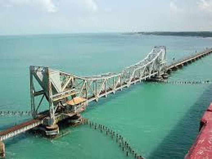 It is Pamban bridge connecting to the holy city of Rameshwaram from the mainland of India. The span gets opened for the ships pass through & the span weighs 450 tonnes. Water