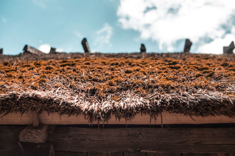Scenic view of hay roof against sky