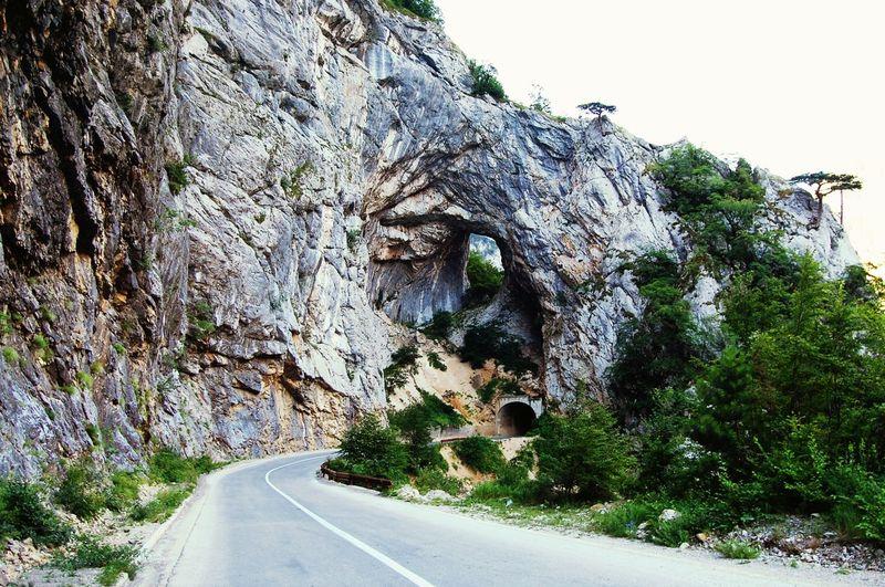 Road passing through rocks
