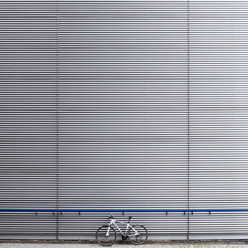 Mywhitebike Mywhitebike Fujix_berlin Ralfpollack_fotografie Minimalism Minimalist Photography  Architecture Built Structure Building Exterior No People Outdoors Bycicle Mode Of Transportation Metal Pattern Day Wall - Building Feature Railing City Wall Transportation Lifestyles Iron Copy Space Silver Colored
