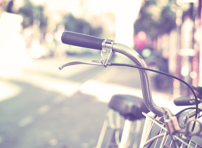 Detail of a Vintage Bicycle Handlebar Resting in the city Street (vintage color toned image) Bicycle Focus On Foreground No People Mode Of Transportation Transportation Close-up Day Handlebar Outdoors City Handle Street Vintage Retro Style Old Sunlight Travel