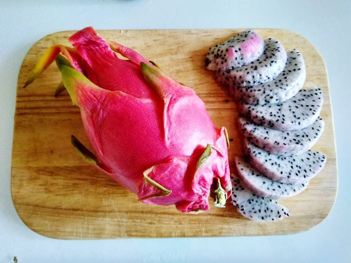 Dragon fruit Red Wood Food Summer Fruit Studio Shot Cutting Board High Angle View Close-up Food And Drink Pitaya Prepared Food Served Chopping Board Halved