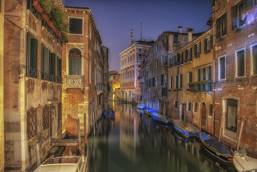 Architecture Architecture Water Reflection Building Exterior Canal Built Structure Building Gondola - Traditional Boat Night Waterfront Travel Destinations No People Illuminated Residential District Transportation Mode Of Transportation Nautical Vessel City Nature Sky