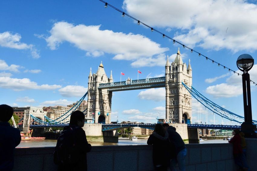 EyeEm LOST IN London Connection Built Structure Sky Bridge - Man Made Structure Architecture Real People Cloud - Sky Travel Destinations Men Lifestyles Suspension Bridge Travel Day Women Leisure Activity Outdoors Transportation Two People City Building Exterior London Tower