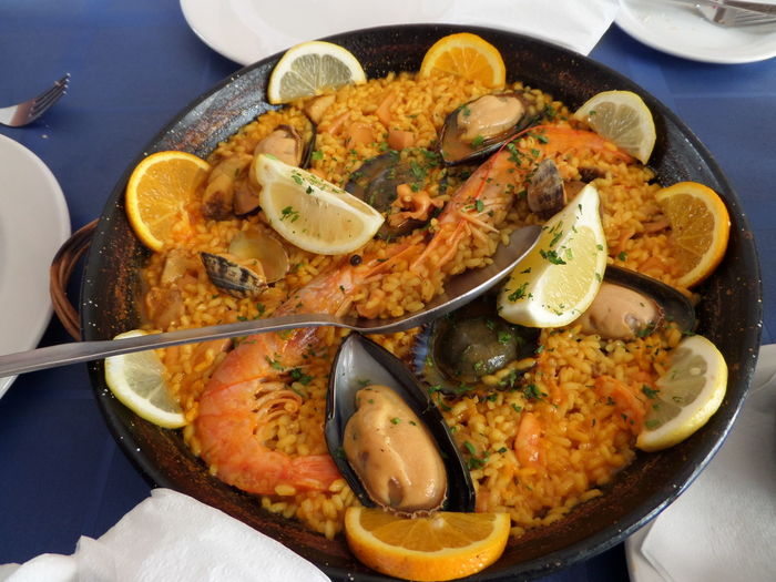High Angle View Of Paella In Container On Table