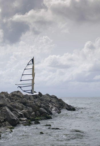 Lifestyle Abandoned Beach Beachphotography Beauty In Nature Black Sea Cloud - Sky Day Fly Board Horizon Horizon Over Water Kite Boarding Nature Old Outdoors Rock Scenics - Nature Sea Sky Surfboard Torn Wakeboard Water Waterfront Windsurf Stay Out