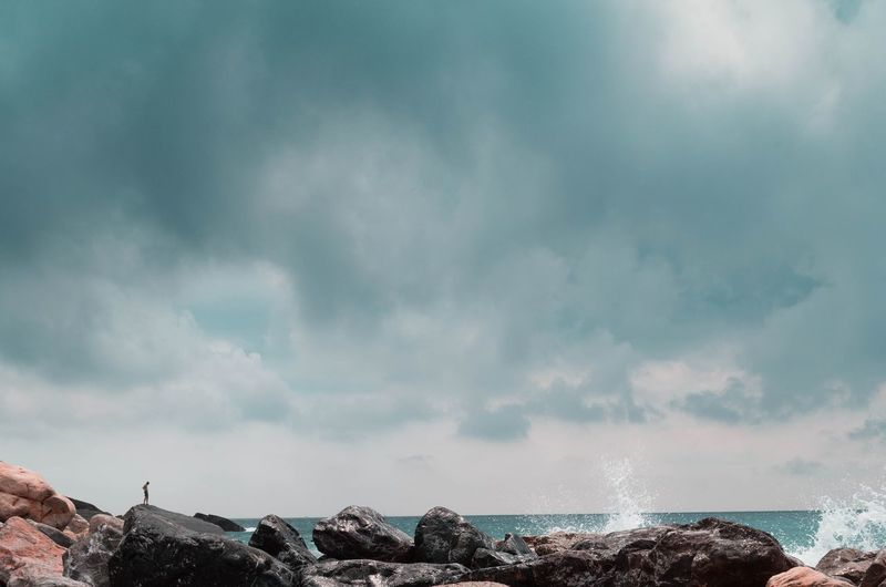 Panoramic view of sea and rocks against sky