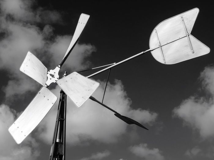 Close-up of windmill against sky