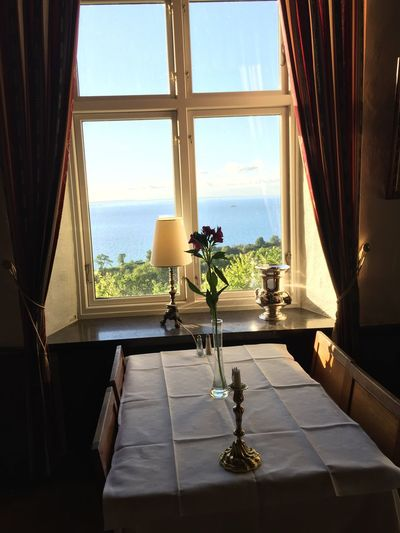 Finished dinner and the sun is still up. Window Table Looking Through Window