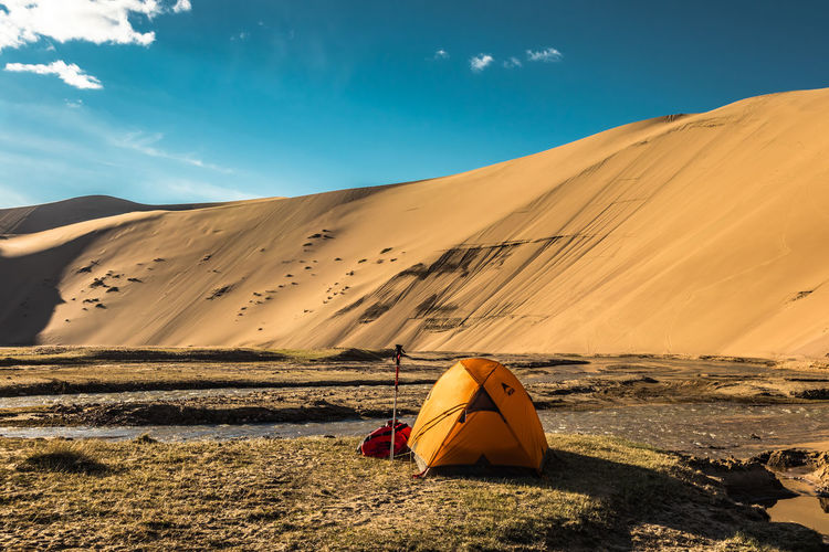 Mongolia Scenics - Nature Beauty In Nature Tranquility Environment Land Nature Landscape Remote Sunlight Tranquil Scene Non-urban Scene Sky Sand Desert Sand Dune Real People Arid Climate Adventure Climate Mountain Outdoors The Traveler - 2019 EyeEm Awards