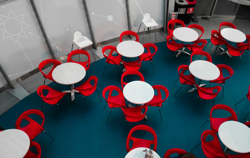 High angle view of empty chairs and tables at restaurant