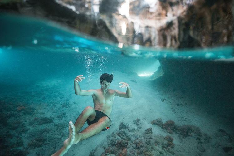 Full length of man swimming underwater