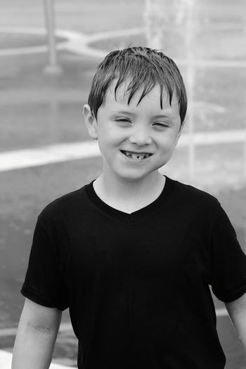 fun at the water park Ways Of Seeing Excitement Facial Expression Kids Being Kids Bnw Autism Black And White Kids Having Fun Squinting Bright Day Black And White Portrait Photography EyeEm Selects Child Portrait Childhood Smiling Boys Happiness Looking At Camera Children