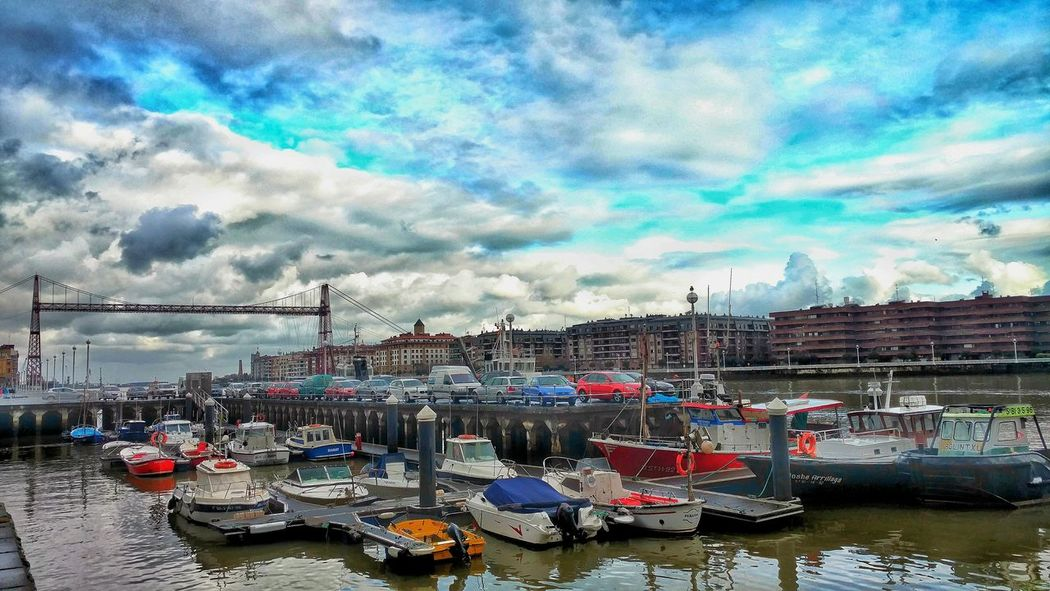 Sky Water Cloud - Sky Transportation Nautical Vessel Mode Of Transport Architecture Outdoors Built Structure River Building Exterior Day Moored City Travel Destinations No People Cityscape Portugalete Euskadi Euskalherria
