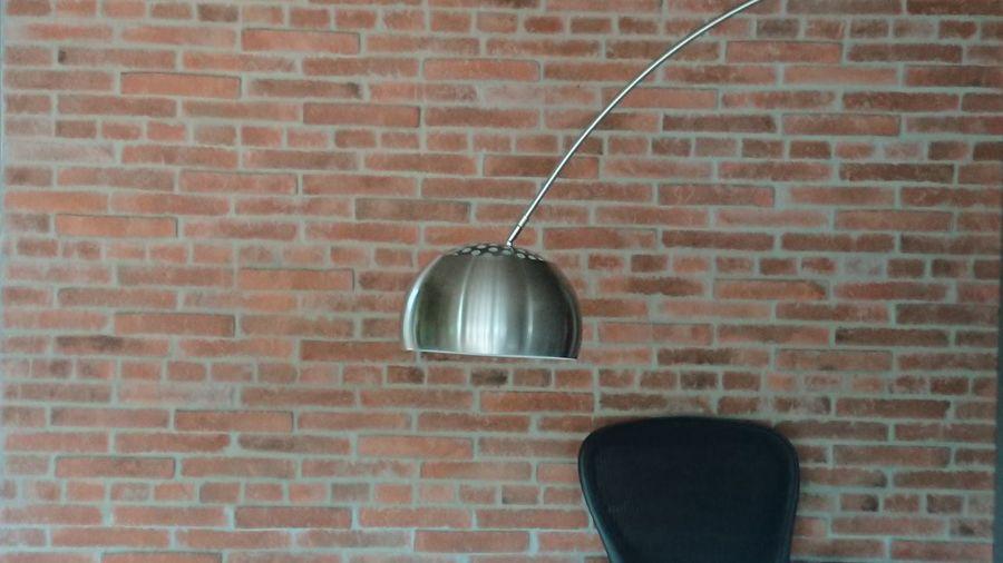 Electric lamp on brick wall