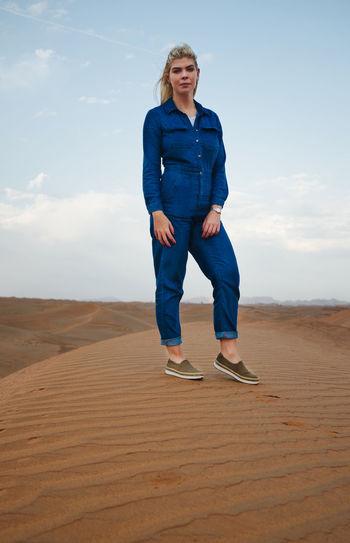 Full length of man on sand dune