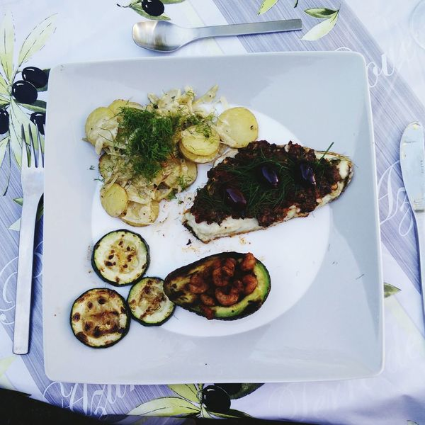 Sea Bass Fish with Sundried Tomatoes Anchovies Capers Garlic Avocado Spicy Shrimps Pimenton Char-grilled Boulanger of Potatoes and Fennel in White Wine and Cream Sauce