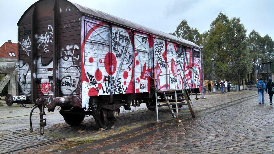 Graffiti On Old Railroad Car On Street In City