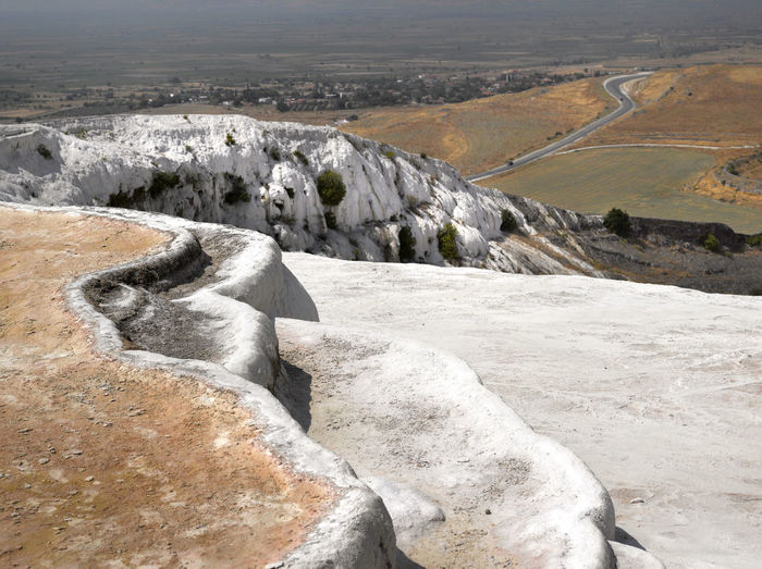 Scenic view of rock formations on landscape at pamukkale