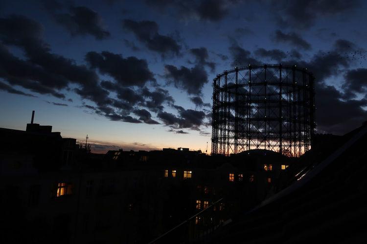 Silhouette built structure against sky