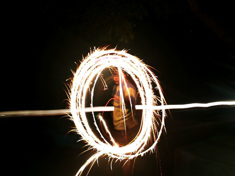 People Outdoors Fireball Adult Wire Wool Firework - Man Made Object Performance Arts Culture And Entertainment Circle Night Sparkler Light Painting Firework Display Long Exposure Celebration Motion Burning Illuminated Skill  Happydiwali EyeEmNewHere The Week On EyeEm