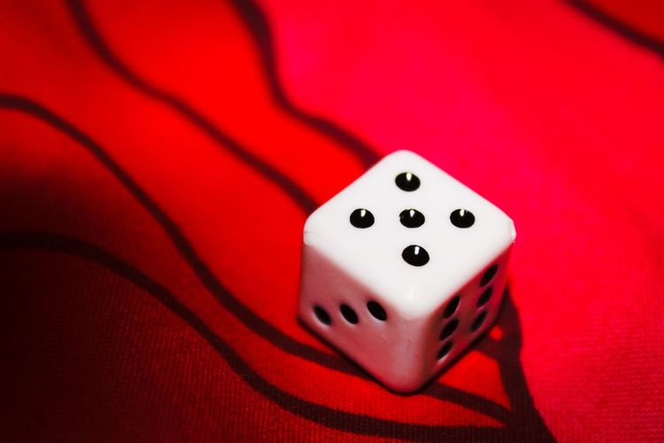 Close-Up Of Lucky Dice On Red Background