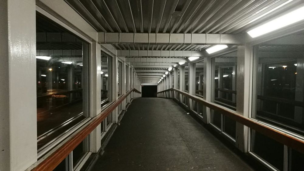 Indoors  No People Illuminated Architecture Tunnel Path Bridge Walkway Footpath Sheltered Night Steel Windows Arch Square