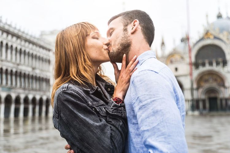 Couple kissing in city