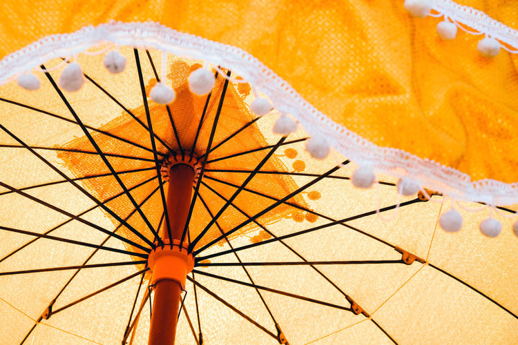 Details of ancient umbrellas used in the ordination ceremony Ancient Art And Craft Ordination Thailand Backgrounds Close-up Day Nature No People Orange Color Ordination Ceremony Outdoors Pattern Protection Security Sky Spoke Umbrella Umbrellas Yellow