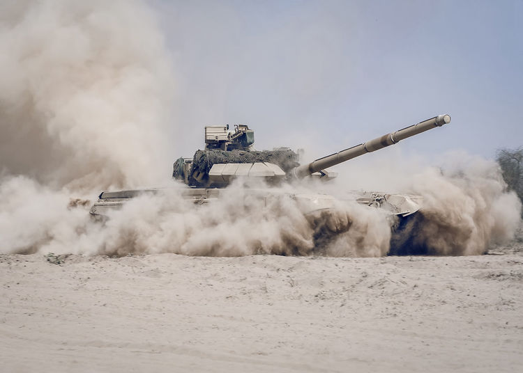 tank Desert Russia Armored Tank Conflict Construction Industry Day Dust Industry Land Land Vehicle Machinery Military Mode Of Transportation Outdoors Protection Security Tank Transportation War Weapon Machine Machine Gun Gun